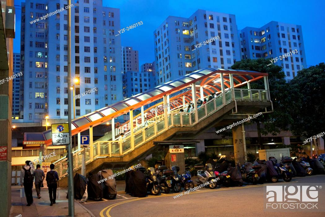 Stock Photo: pedestrian footbridge and residential apartments at Kowloon Bay, China.