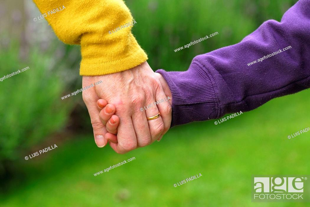 Stock Photo: Mother and daughter's hands.