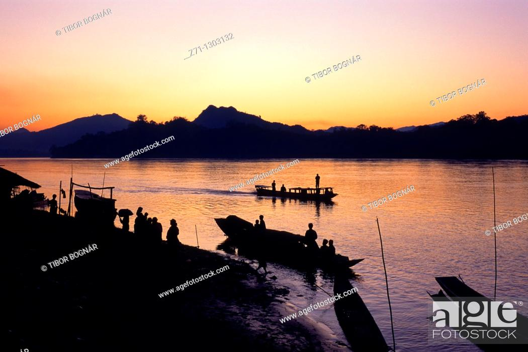 Stock Photo: Laos, Luang Prabang, Mekong river, boats, people, sunset,.