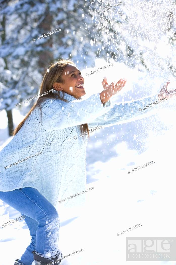 Stock Photo: Young woman playing in the snow.