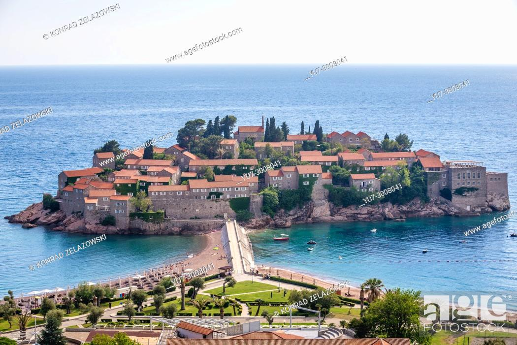 Stock Photo: Distance view of Sveti Stefan islet and five star Aman Sveti Stefan hotel resort on the Adriatic coast of Montenegro.