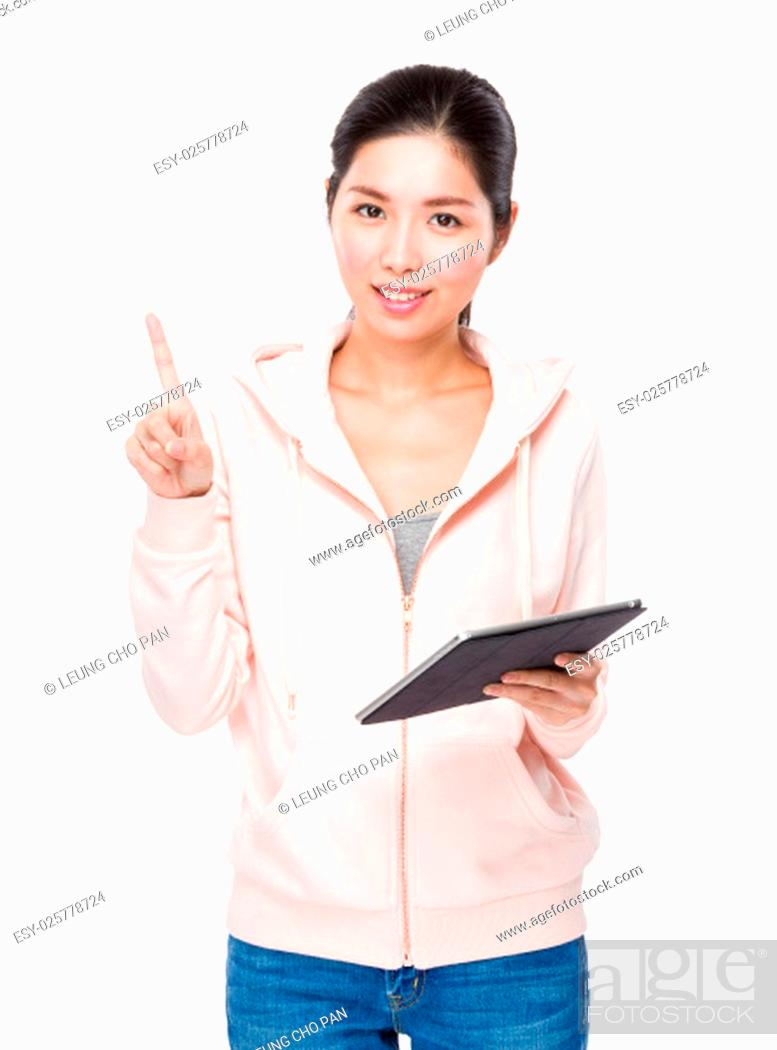 Stock Photo: Young Woman use of the tablet and finger point up.