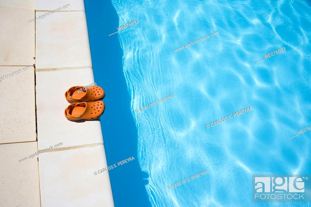 Stock Photo: Playing in a pool in the Provence of France.