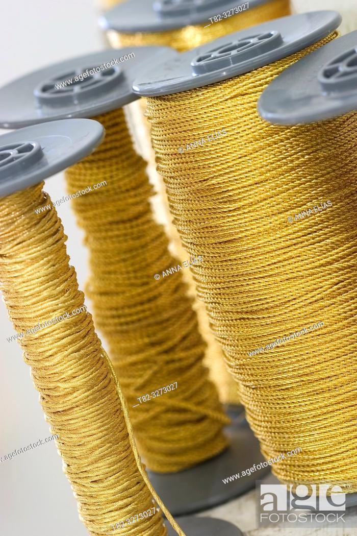 Imagen: Gold and silver thread spools for cofrade crafts, Holy Week, Andalusia, Spain.