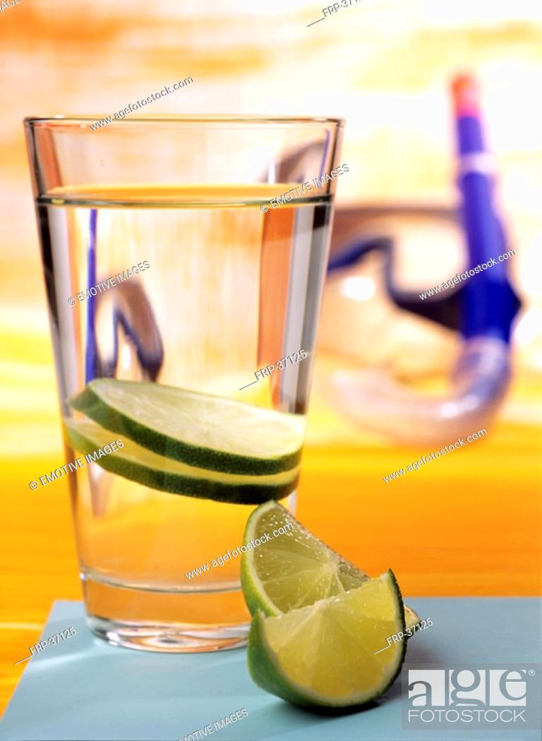 Stock Photo: Glass of water with slices of lime.
