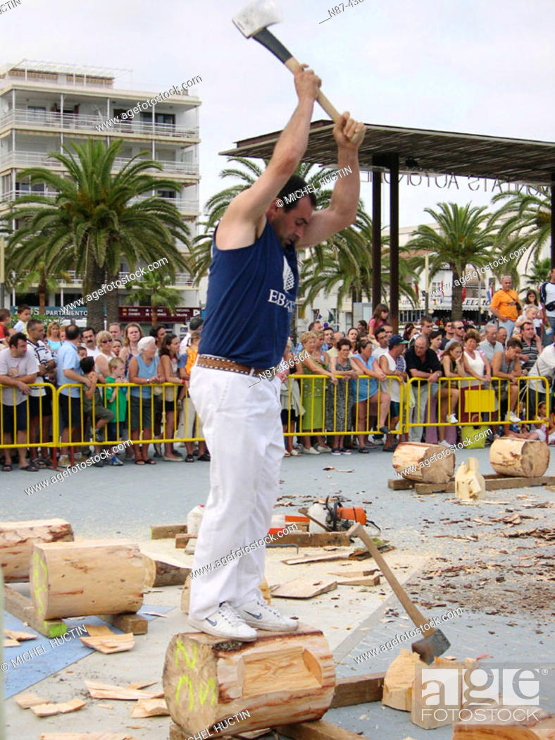 Stock Photo: 'Aizkolari' man cutting log with an axe, demonstration of 'aizkora' (traditional Basque sport). Salou, Tarragona province. Catalonia, Spain.
