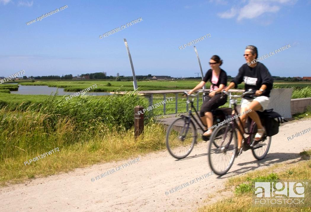 Stock Photo: Bikers along the old railway the Groene 62, between Torhout and Ostend, Belgium.