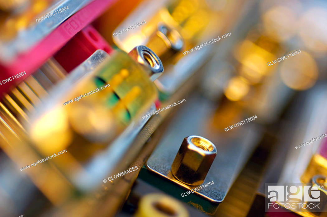 Stock Photo: Close-up of a nut on a circuit board.