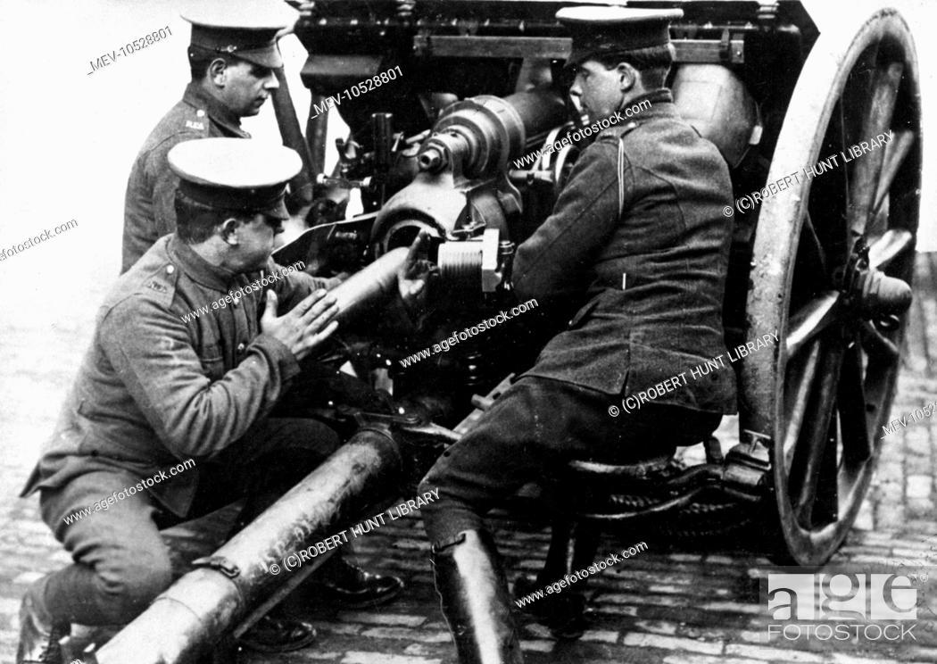 Loading a British field gun during the First World War