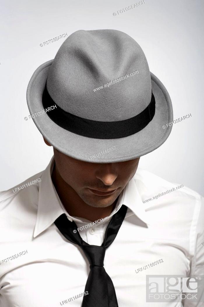 Stock Photo: Mid adult man wearing fedora.