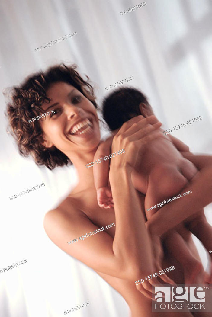 Stock Photo: Close-up of a mother carrying her baby boy.