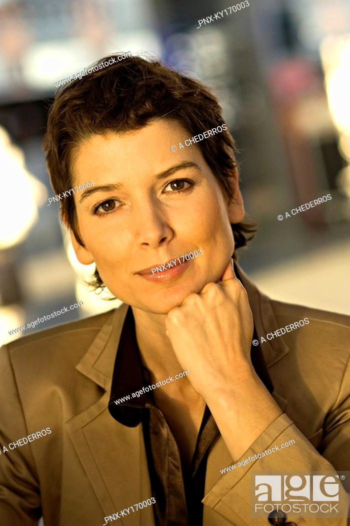 Stock Photo: Portrait of a businesswoman thinking with her hand on her chin.