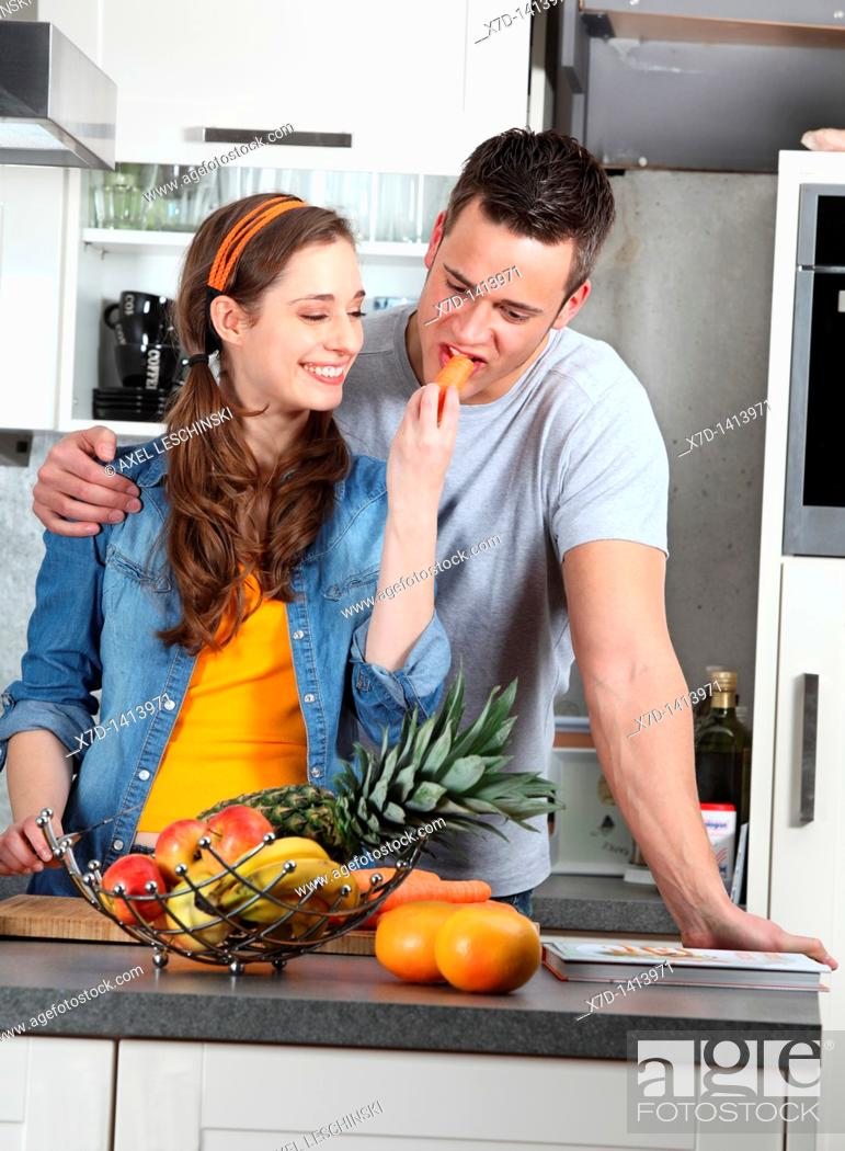 Stock Photo: couple cooking together.