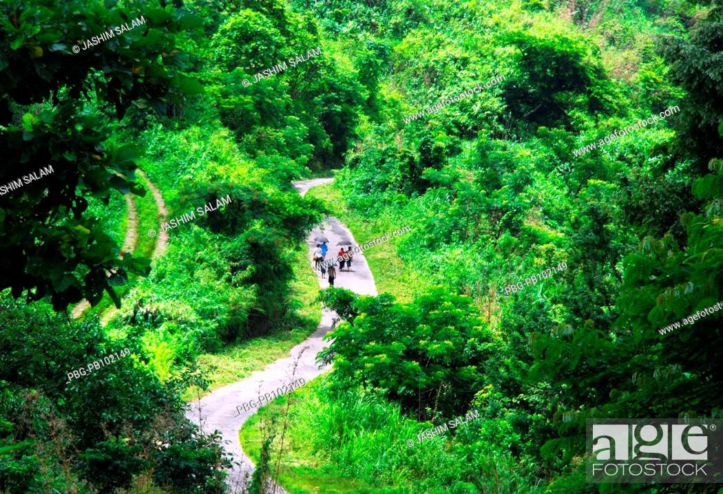 Stock Photo: Ethnic people of Bandarban start their journey through zigzag road Bandarban, Bangladesh July 2008.