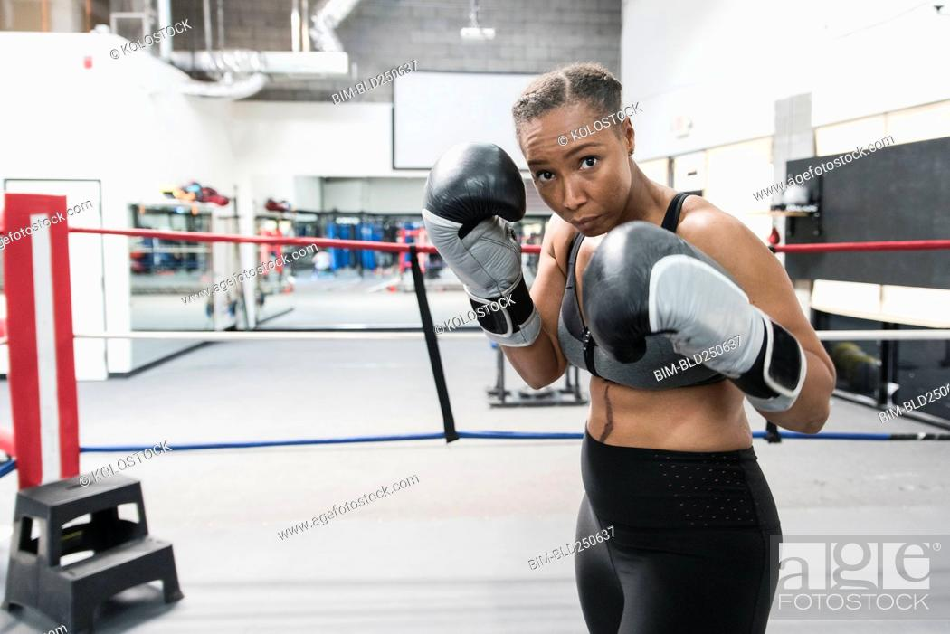 Stock Photo: Black woman posing in boxing ring.