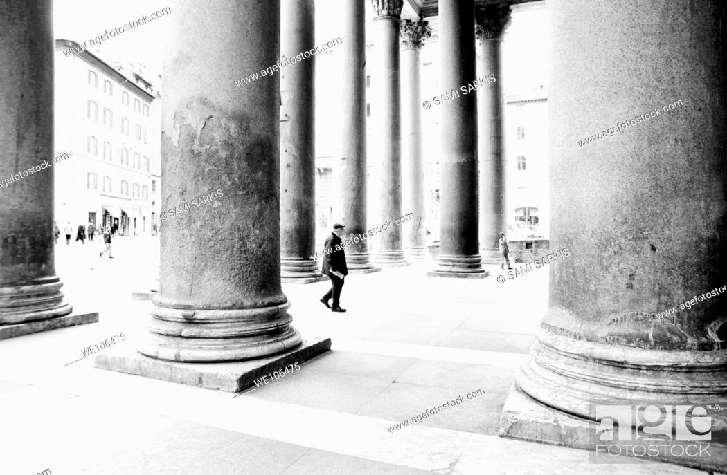 Stock Photo: People walking in between the large columns of the Pantheon, Rome, Italy.