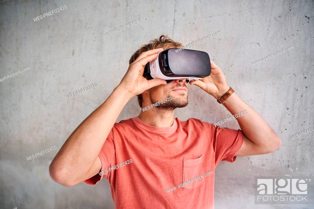 Stock Photo: Young man wearing virtual reality goggles.