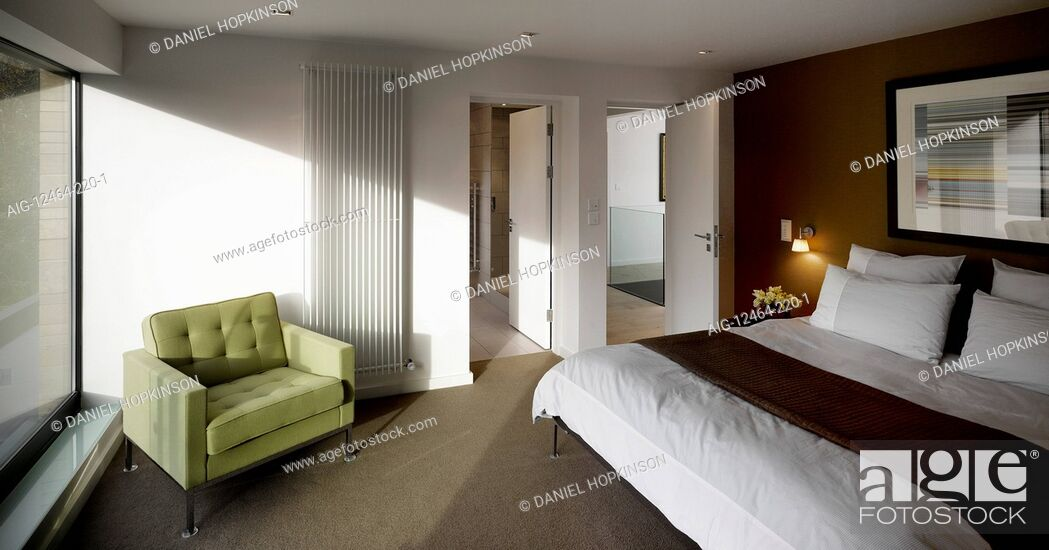 Stock Photo: Bedroom with green chair, Private House, Worsley.