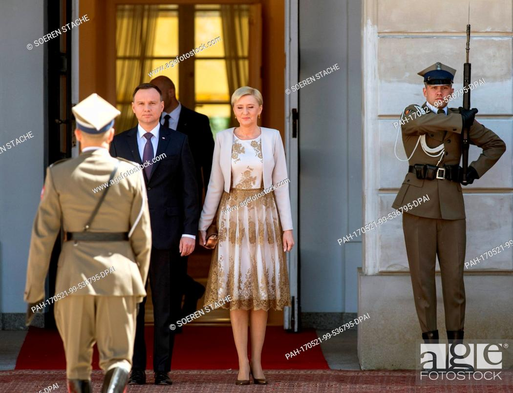 Stock Photo: Polish President Andrzej Duda (2-L) and his wife Agata Kornhauser-Duda (C) await the arrival of German President Frank-Walter Steinmeier (not pictured) in front.
