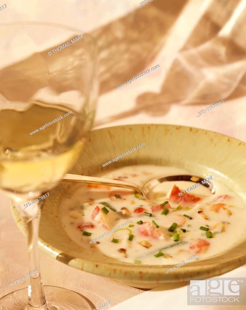 Stock Photo: Bowl of Lobster Bisque with a Glass of White Wine.