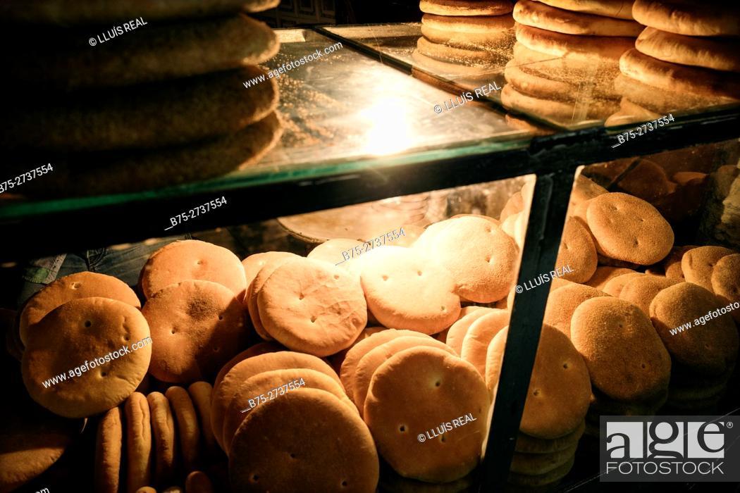 Stock Photo: Showcase full of basic Moroccan bread in bakery. Fez, Morocco.