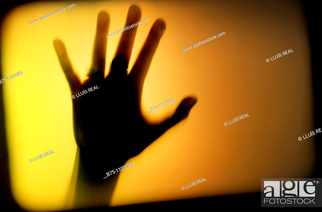 Stock Photo: silhouetted hand.