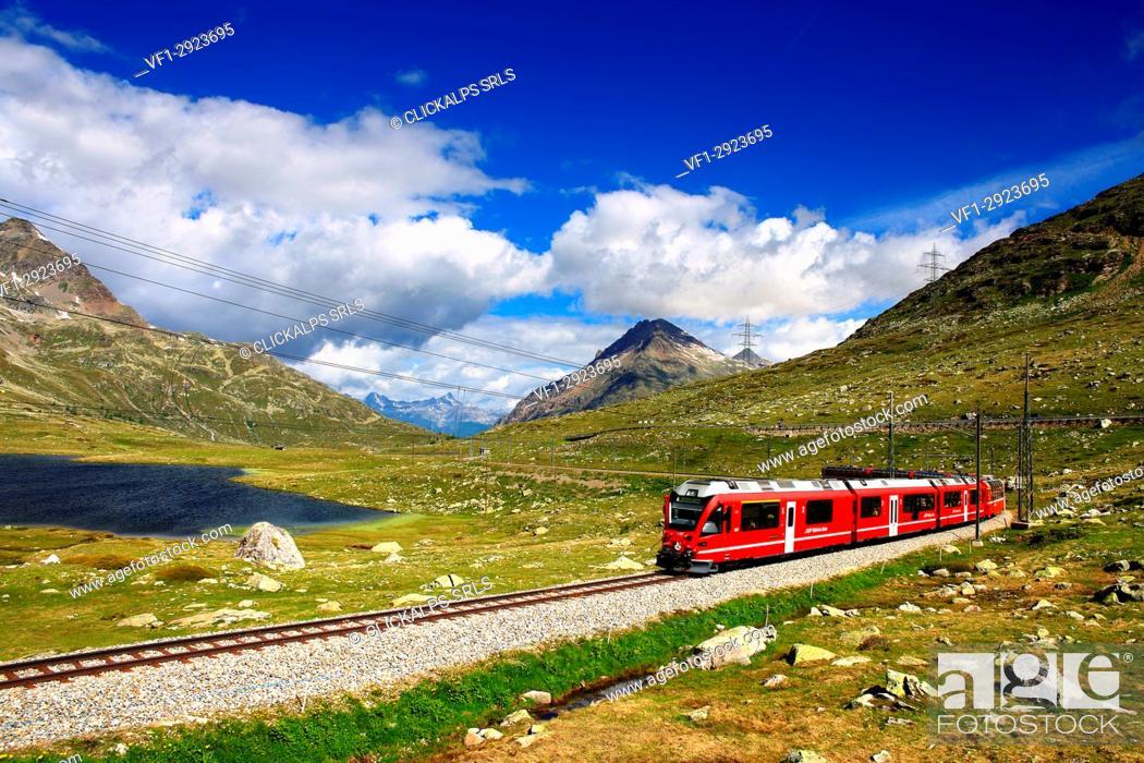 Stock Photo: Bernina Pass with bernina express near at blak lake, Graubünden, Switzerland.