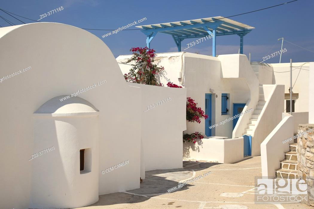 Stock Photo: View to the traditional whitewashed houses at the town center of Naoussa, Paros Island, Cyclades Islands, Greek Islands, Greece, Europe.