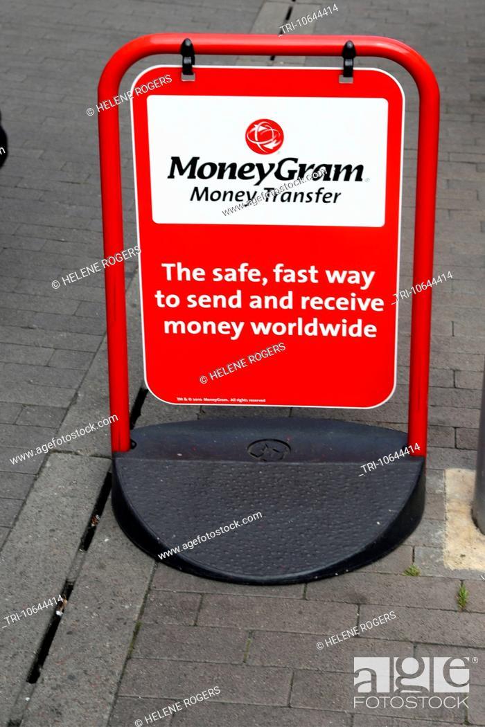 Stock Photo Swing Board Pavement Sign For Moneygram Money Transfer Surrey England