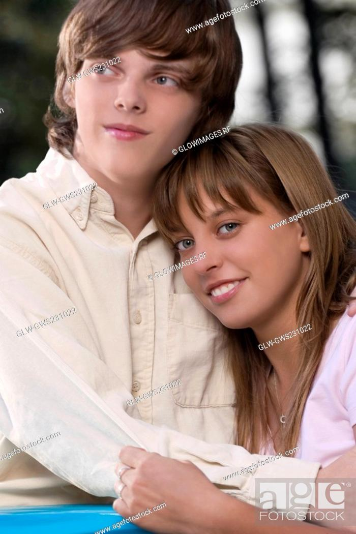 Stock Photo: Close-up of a teenage couple embracing each other.