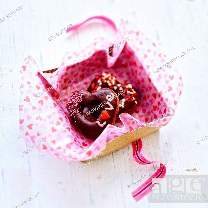 Stock Photo: Saint Valentine chocolate donuts.