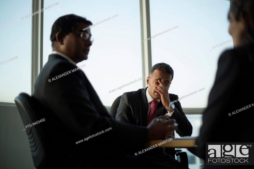 Stock Photo: Singapore, Three business colleagues in discussion.