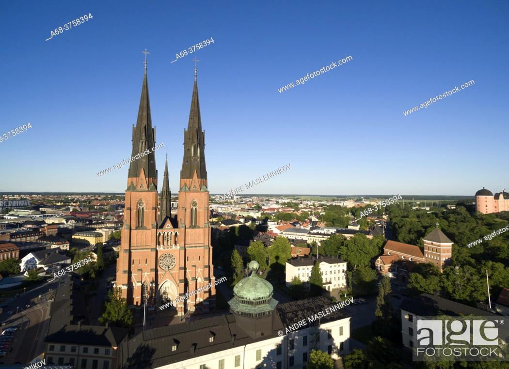 Stock Photo: Uppsala Cathedral with Gustavianum in the foreground. To the right Helga Trinity Church and the castle. Sweden.