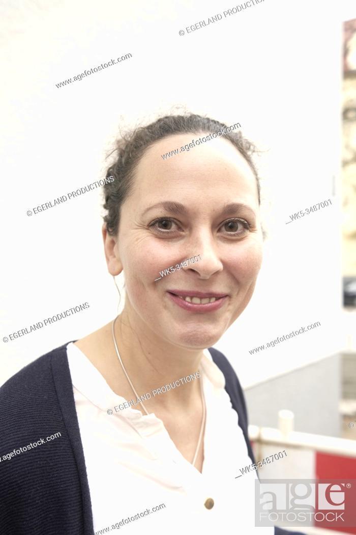 Stock Photo: Portrait of impish Woman smirking, Munich, Germany.