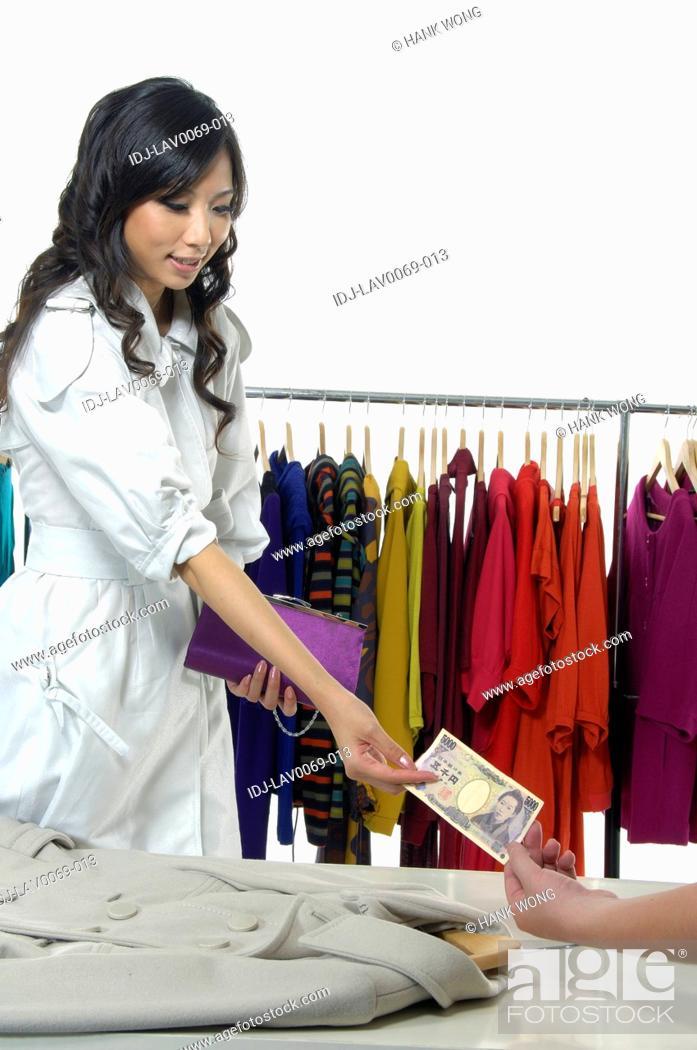 Stock Photo: Woman paying money in a clothing store.