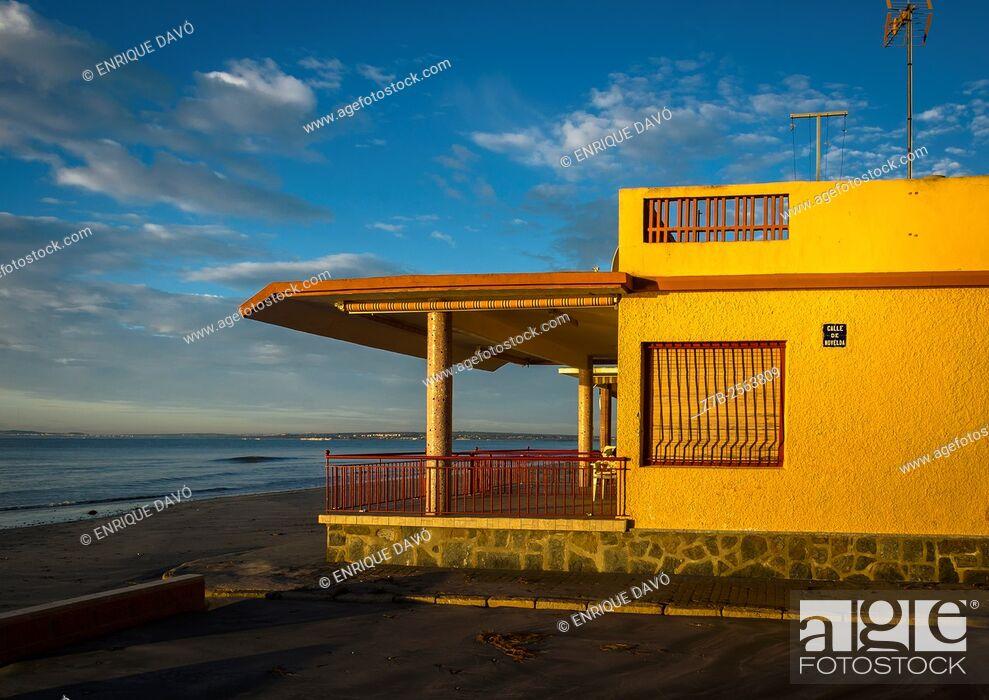 Stock Photo: A yellow side house in Playa Lisa beach, Alicante coast, Spain.