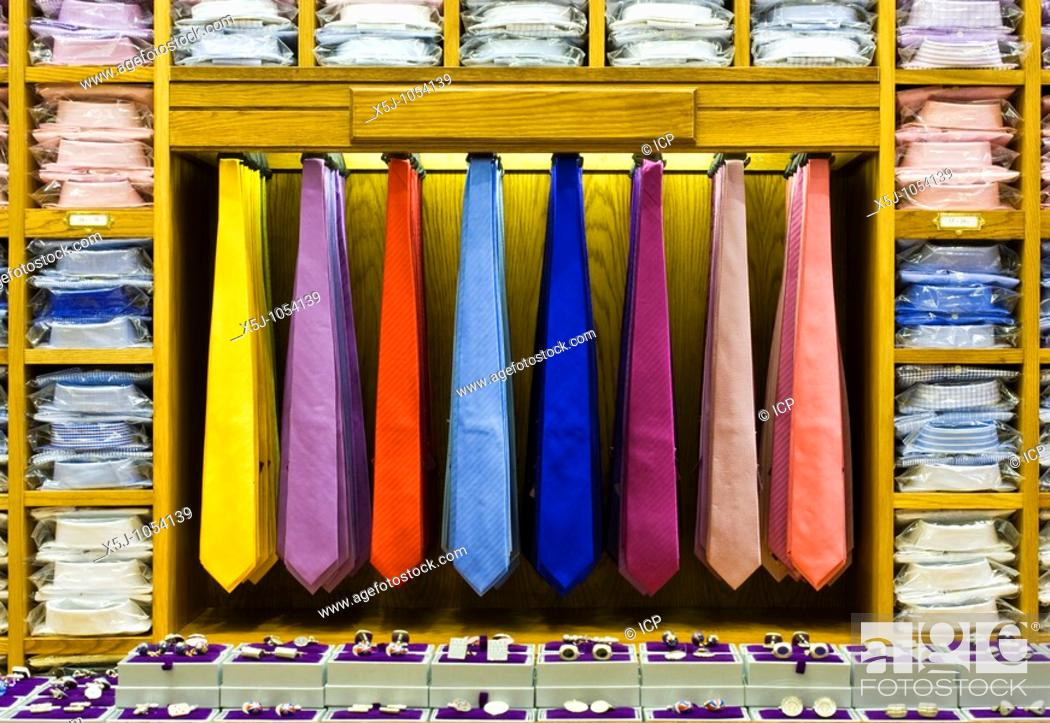 Stock Photo: Colourful ties, shirts and cufflinks on display in a retail store.