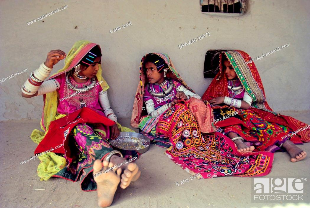 Stock Photo: Woman Busy with embroidery work , Kutch , Gujarat , india.