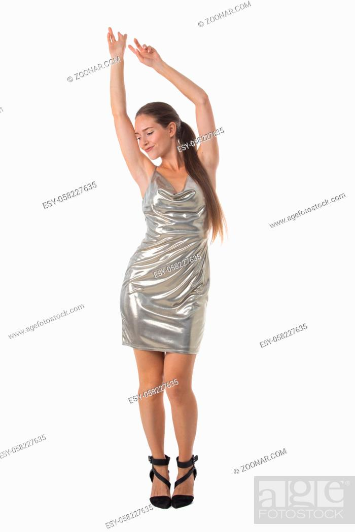 Stock Photo: Full length portrait of young party dancing girl in silver dress isolated over white background.