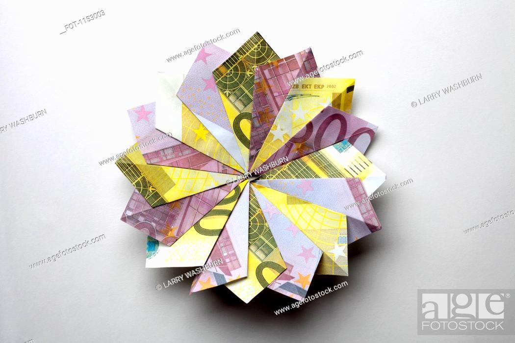 Stock Photo: European Union currency folded into a pinwheel shape.