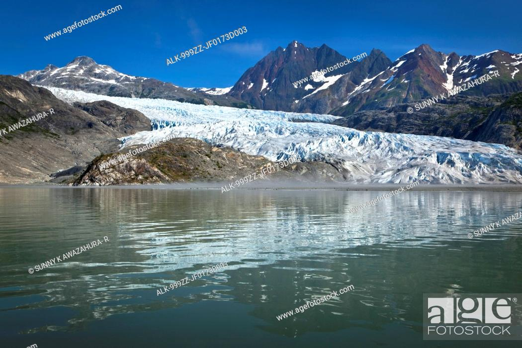 Stock Photo: Scenic view of Riggs Glacier reflecting on the water of Muir Inlet, Glacier Bay National Park & Preserve, Southeast Alaska, Summer.