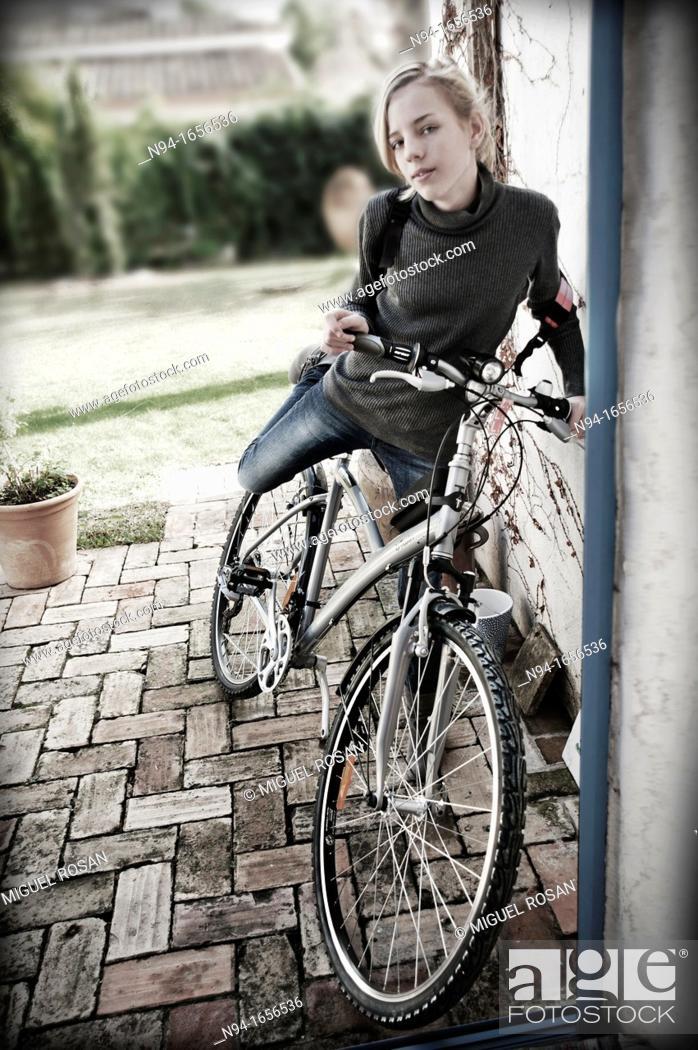 Stock Photo: Blonde teen girl on bike.