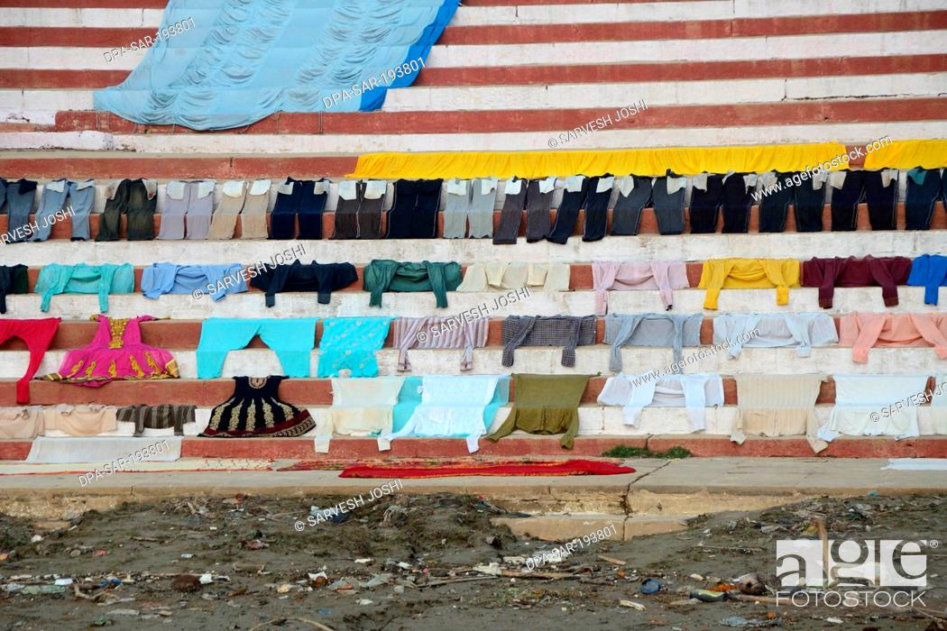 Stock Photo: Clothes drying on steps ganga river, varanasi ghat, uttar pradesh, india, asia.