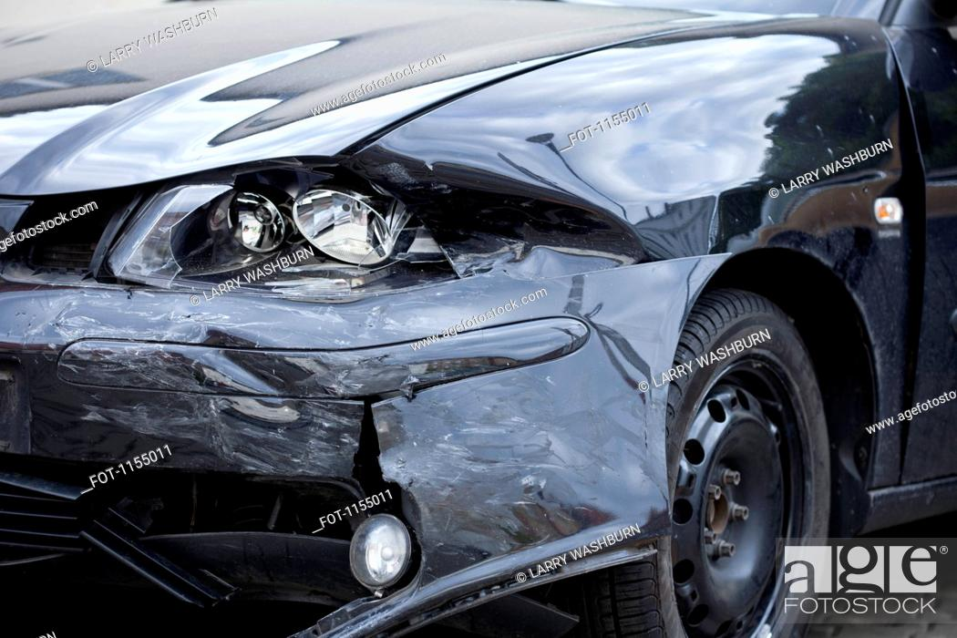 Stock Photo: Damaged car with distorted reflection of town.