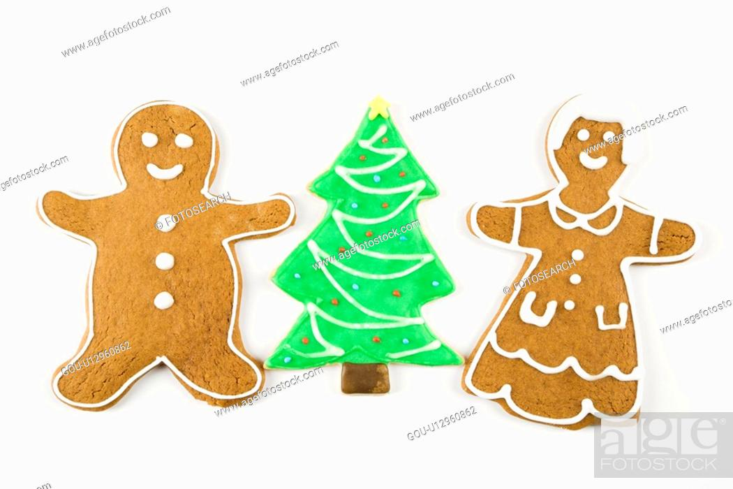 Stock Photo: Sugar cookie Christmas tree between gingerbread male and female.