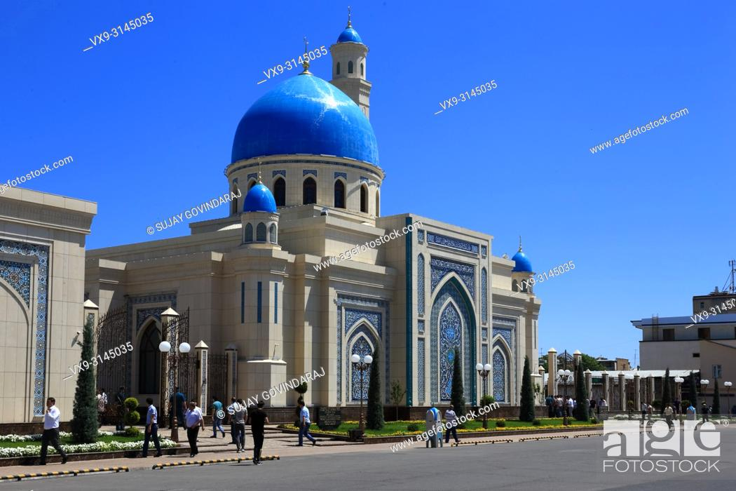 Stock Photo: Tashkent, Uzbekistan - May 12, 2017: Uzbek people entering the mosque to offer prayer to the God.