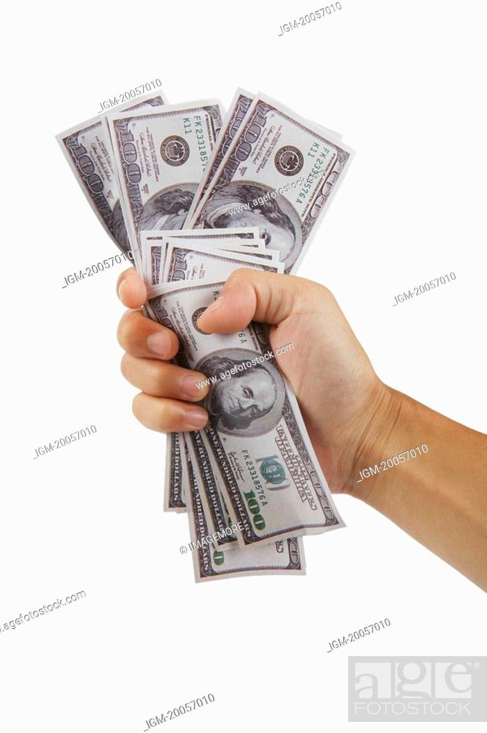 Stock Photo: Human hand holding a handful of US paper currency.