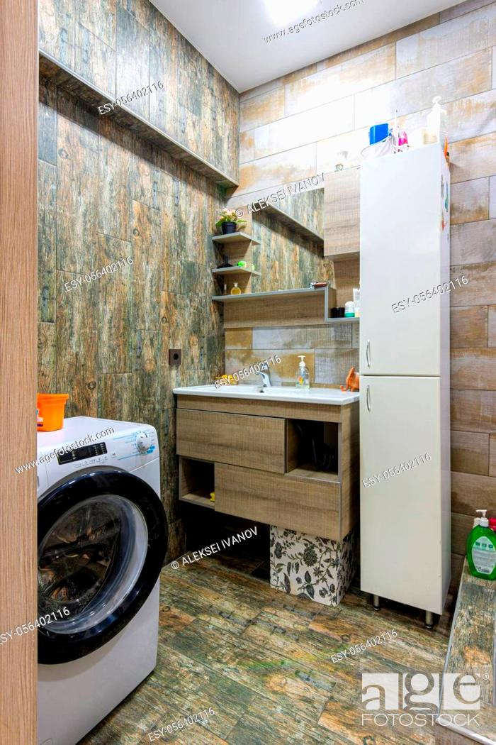 Stock Photo: Interior of a cozy compact modern bathroom with a washing machine.