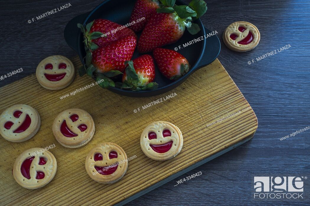 Stock Photo: Strawberry cookies in the shape of a face.