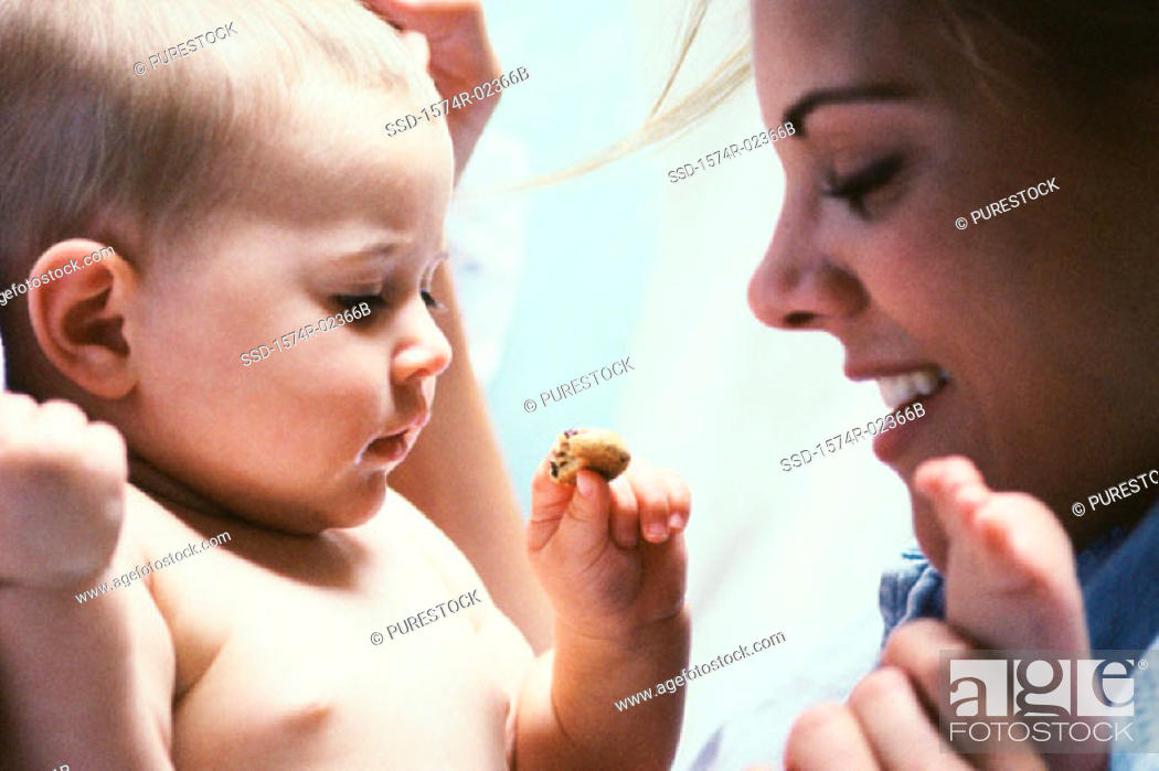 Stock Photo: Mother playing with her baby boy.